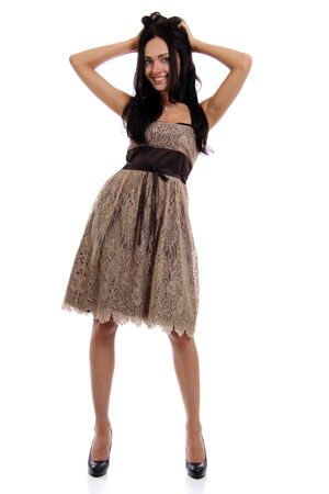 Full length of a beautiful young lady in  dress standing against isolated white background Stock Photo - 9509595