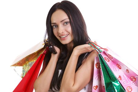 Shopping woman smiling. Isolated over white background Stock Photo - 9513428