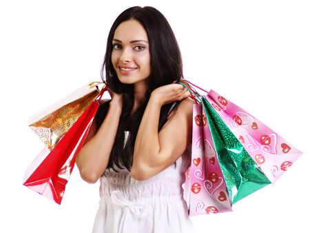 Shopping woman smiling. Isolated over white background  Stock Photo - 9513542