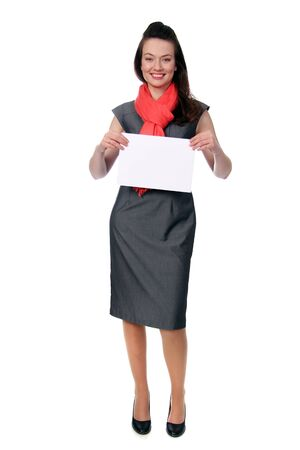 woman holding a blank sign in business wear photo