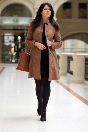 beautiful young woman waling in the shop Stock Photo - 9509910
