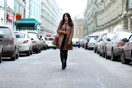 beautiful young woman walking on the street  Stock Photo - 9509912