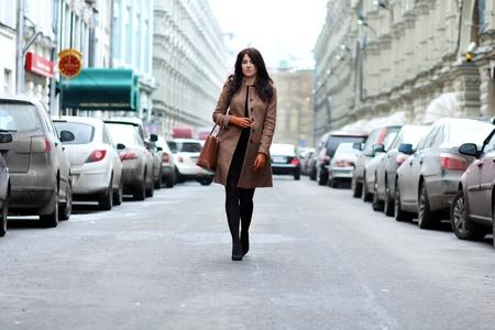 beautiful young woman walking on the street Stock Photo - 9509912