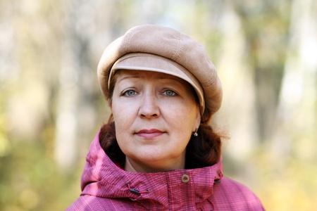 one senior adult woman: Closeup portrait of a happy mature woman Stock Photo