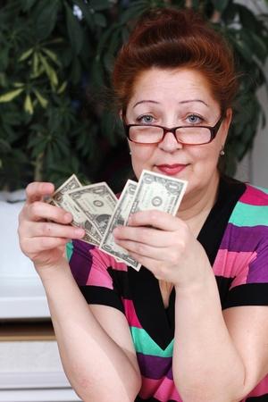 Senior woman counting savings money photo