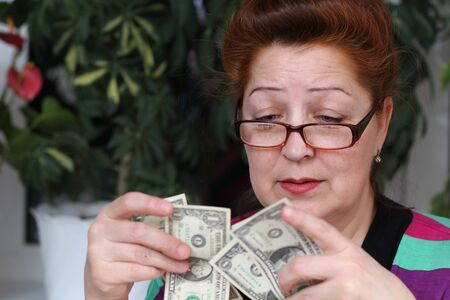 Senior woman counting savings money Stock Photo - 9534226