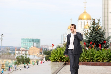 russian man: young man with mobile phone outdoors  Stock Photo