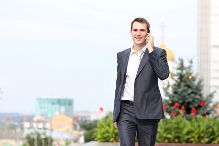 young man with mobile phone outdoors  Stock Photo