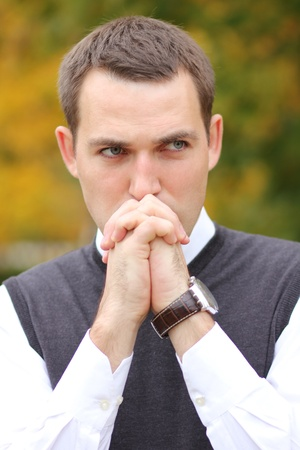 Portrait of young attractive gloomy man Stock Photo - 10831669