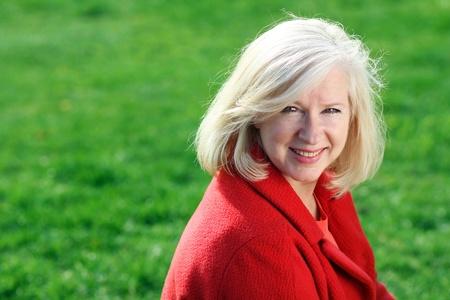 Closeup portrait of a happy mature woman Standard-Bild