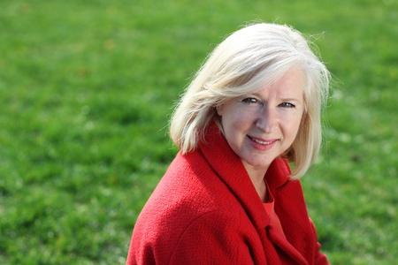 Closeup portrait of a happy mature woman photo