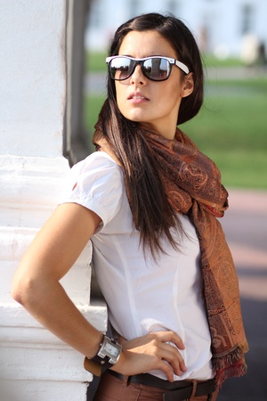 Beautiful young woman in sunglasses. Outdoor portrait  photo