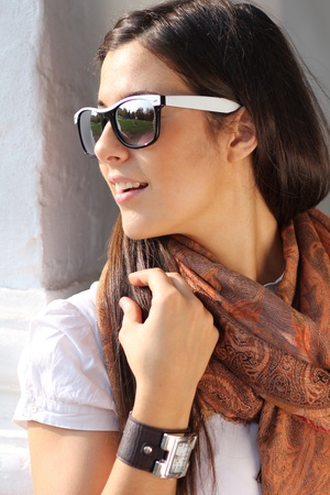 woman close up: Beautiful young woman in sunglasses. Outdoor portrait