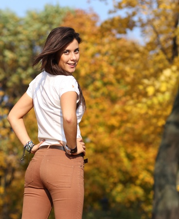 ass standing: Beautiful young woman. Outdoor portrait  Stock Photo