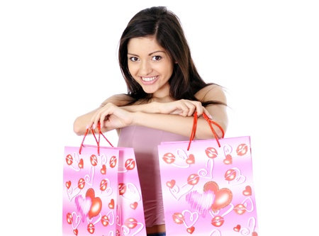 Shopping woman smiling. Isolated over white background  Stock Photo - 11359860