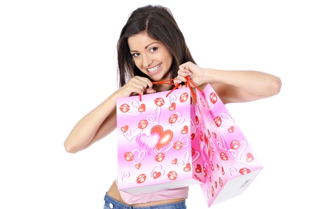 Shopping woman smiling. Isolated over white background Stock Photo - 11359890