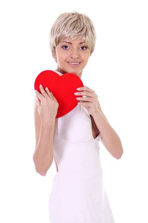 Portrait of a attractive young woman holding a red heart over white background photo