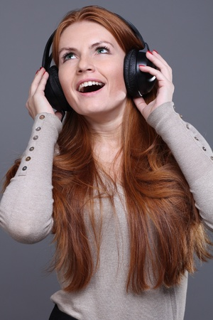 happy young woman listening to music  photo