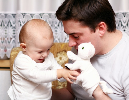 father and baby play in the home