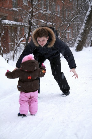 Happy baby and father outdoor in winter