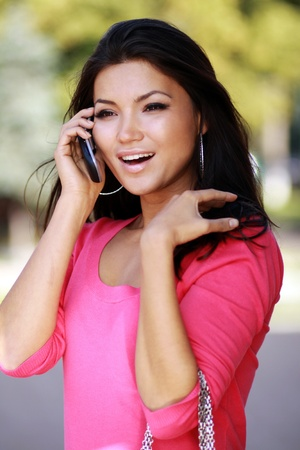 asian young woman calling by phone photo