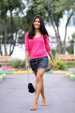 Asian young woman on outdoor background photo