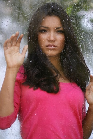 asian young woman in the rain photo