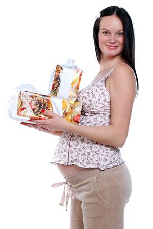 portrait of pregnant woman with gift boxes  photo