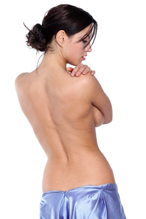 Skincare concept: back of beautiful nude woman with soft skin