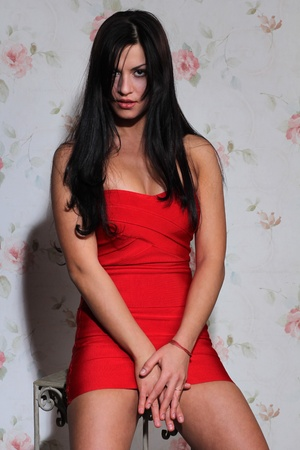 sexy woman in red dress photo