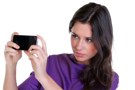 Girl posing for a photograph taken from his cell phone  Stock Photo