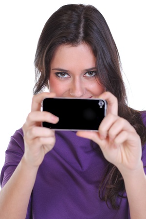 Girl posing for a photograph taken from his cell phone  Imagens