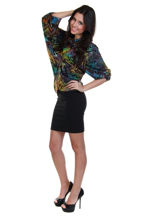 Full length of a beautiful girl in black skirt and colorful blouse photo