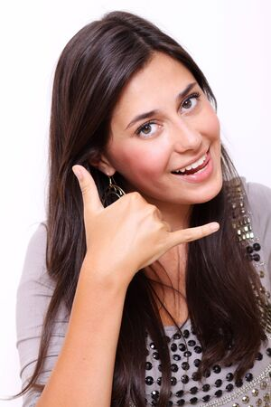 picture of lovely woman making a call me gesture Stock Photo - 12503034