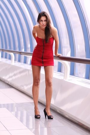 beautiful young woman in a red dress photo