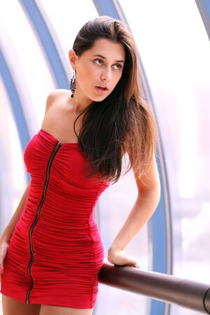 beautiful young woman in a red dress Stock Photo - 12502438