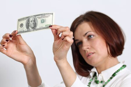young woman holding a 100 dollar bill Stock Photo - 14261902