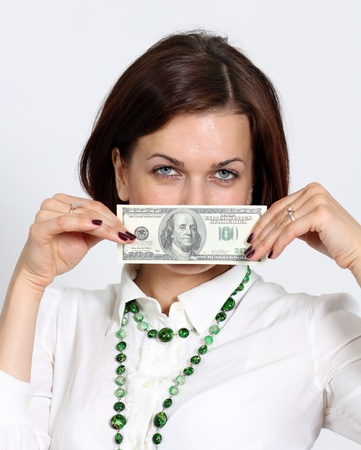 young woman holding a 100 dollar bill Stock Photo - 14262038