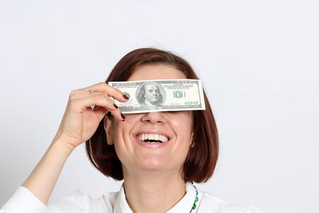 young woman holding a 100 dollar bill Stock Photo - 14261880