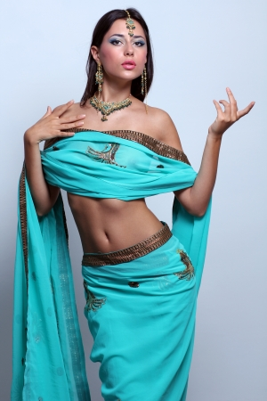 saree: young pretty woman in indian turquoise sari Stock Photo