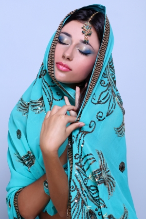 young pretty woman in indian turquoise sari Stock Photo