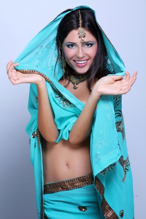 young pretty woman in indian turquoise sari photo