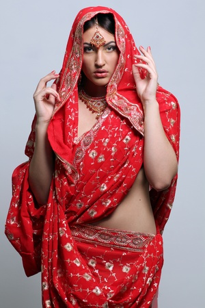 young pretty woman in indian red sari Stock Photo