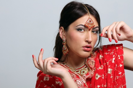 young pretty woman in indian red sari photo