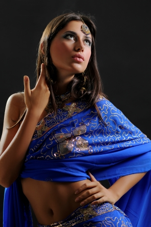 young pretty woman in indian blue dress photo