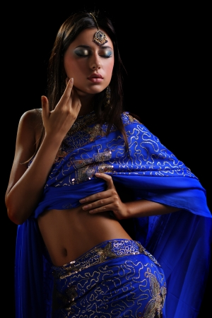sari: young pretty woman in indian blue dress