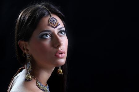 Closeup portrait of beautiful female wearing traditional indian photo