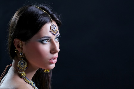 Closeup portrait of beautiful female wearing traditional indian photo