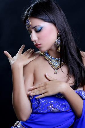 Closeup portrait of beautiful female wearing traditional indian Stock Photo - 14273226