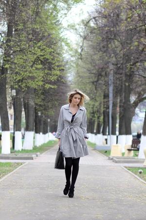 beautiful young woman walking on the street Stock Photo - 14273237